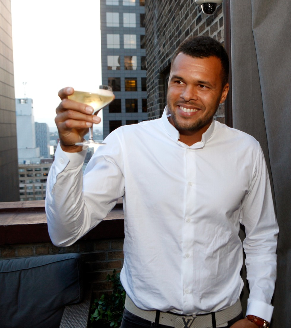 NEW YORK, NY - AUGUST 20:  WestHouse New York toasts Jo-Wilfried Tsonga during Taste of Tennis Week on the Terrace at WestHouse Hotel on August 20, 2014 in New York City.  (Photo by Thos Robinson/Getty Images for AYS)